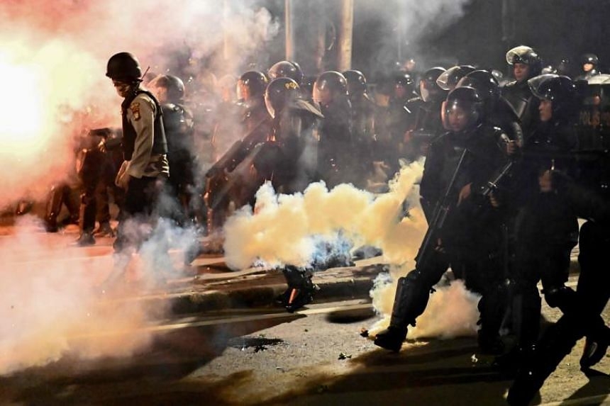 Six people were killed in unrest that gripped parts of Jakarta after the election commission confirmed that President Joko Widodo won last month's election.