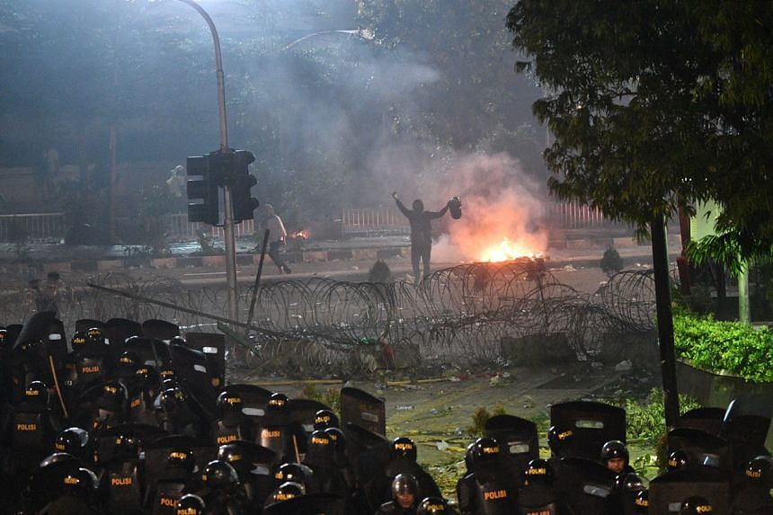 Protesters clashing with police in Sarinah, central Jakarta, on May 22, 2019, following the release of the April 17 presidential election results.