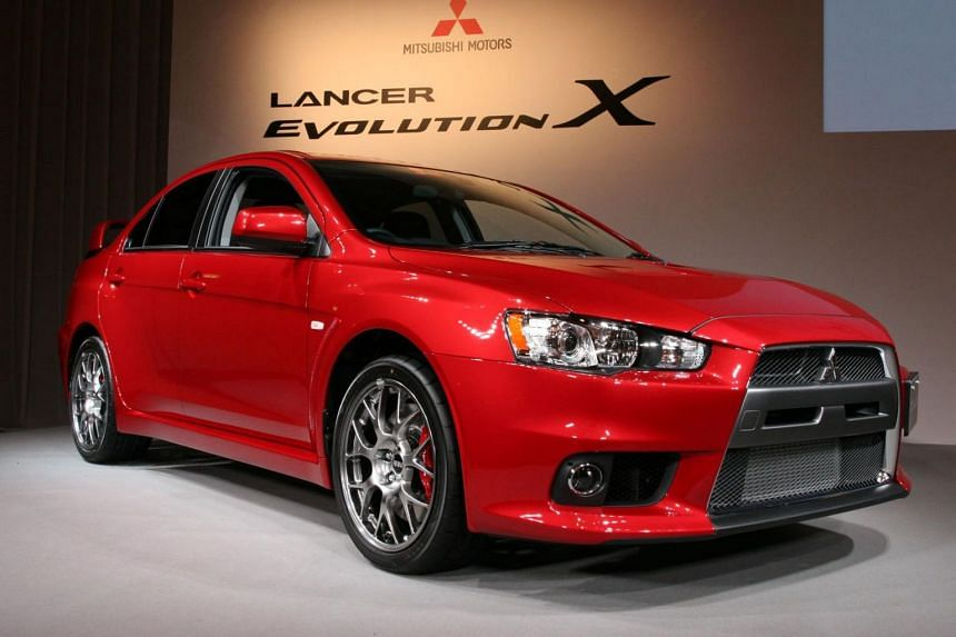 A Mitsubishi Evolution 10 at a showroom in Tokyo. Two men pleaded guilty to driving their Mitsubishi Evolution 10 sedans in a rash manner and were sentenced to two weeks' jail.