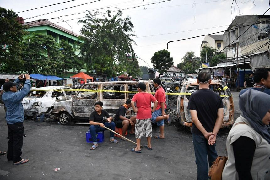 Burnt vehicles at a junction in Pertamburan, Jakarta, where Brimob and protesters clashed.