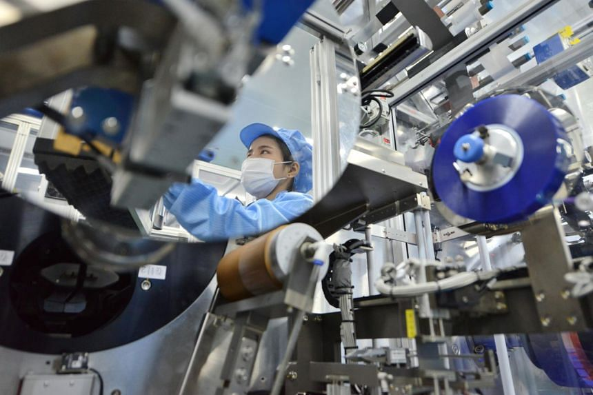 A worker at the production line of lithium-ion batteries for electric vehicles at a factory in Huzhou, China.