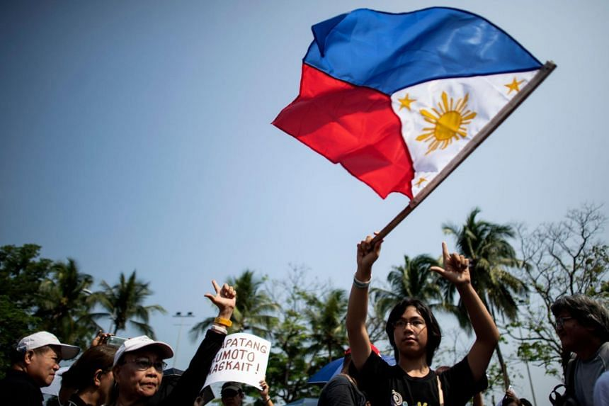 Protesters hold a rally near the Philippine International Convention Center in Manila on May 17, 2019.