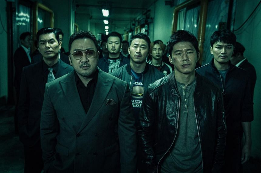 Ma Dong-seok (left), also known as Don Lee, and Kim Moo-yeol star in The Gangster, The Cop, The Devil.