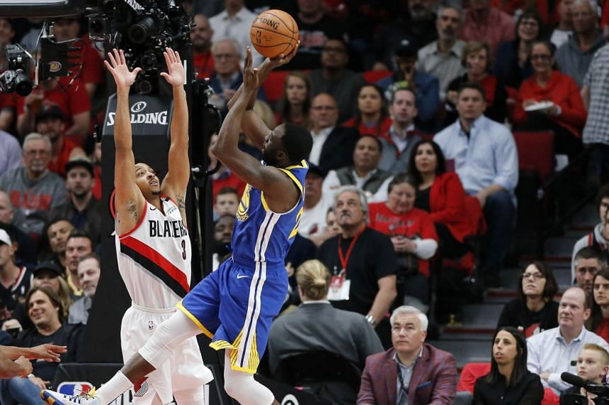 Draymond Green shooting over C.J. McCollum for two of his 18 points in Golden State's 119-117 overtime defeat of the Blazers in Game 4 in Portland.