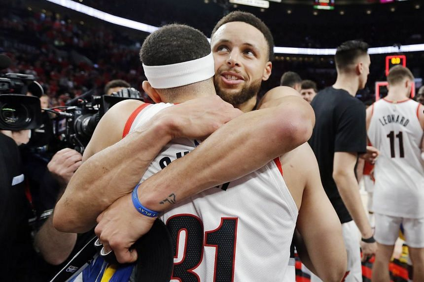 Warriors' Stephen Curry hugging his brother Seth, who played for the Trail Blazers, after Golden State's 4-0 series win in the NBA Western Conference Finals on Monday.