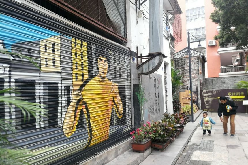 A Bruce Lee mural (above) in Yongqing Fang.