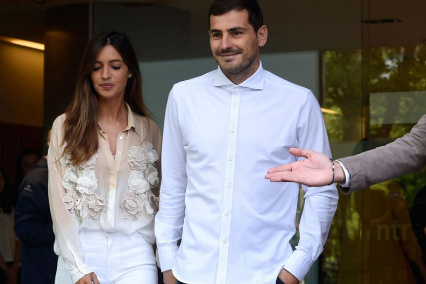 Spanish keeper Iker Casillas (right) leaving CUF Porto hospital accompanied by his wife Sara Carbonero on May 6, 2019.