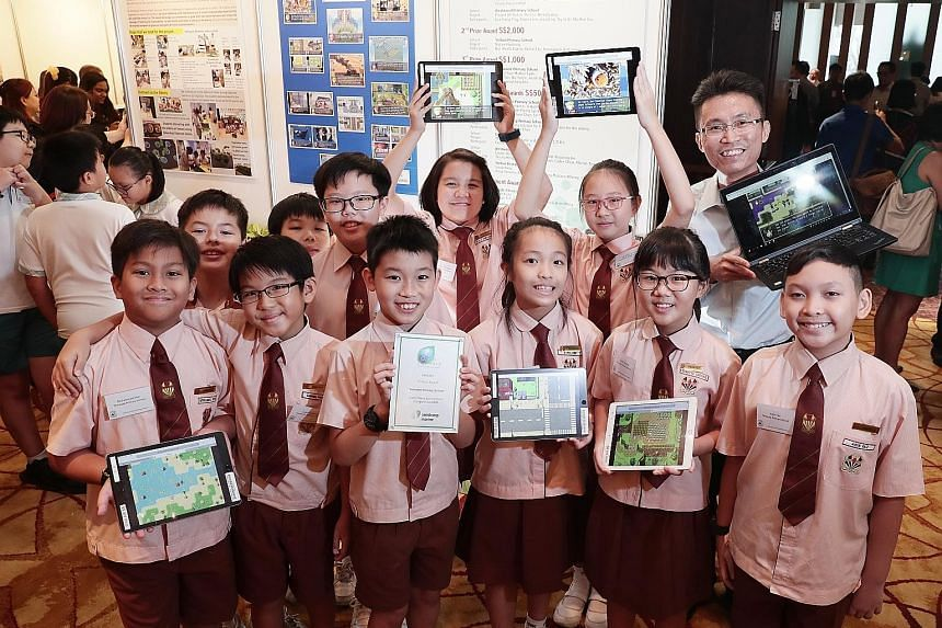 Aidin Faiz Ahmad Ismadi (far right in front row) and his fellow teammates from Temasek Primary School who shared the first prize - with their Westwood Primary counterparts - in the primary school category of the Green Wave Environmental Care Competit