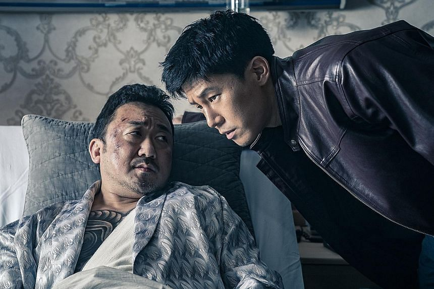 Ma Dong-seok (above left) plays gangster Jang Dong-soo, while Kim Moo-yeol plays cop Jung Tae-suk in The Gangster, The Cop, The Devil.