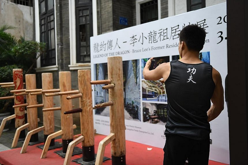 The former residence of Bruce Lee's family in Yongqing Fang, Guangzhou, has been turned into a museum (far left) for the martial arts legend after a demolition plan was derailed by calls for conservation. A Bruce Lee mural (left) in Yongqing Fang.