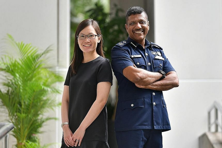 Ms Sylvia Liaw from the Ministry of Home Affairs and Senior Assistant Commissioner Arul David Scott were among the 280 Home Team officers promoted at a ceremony yesterday. ST PHOTO: NG SOR LUAN