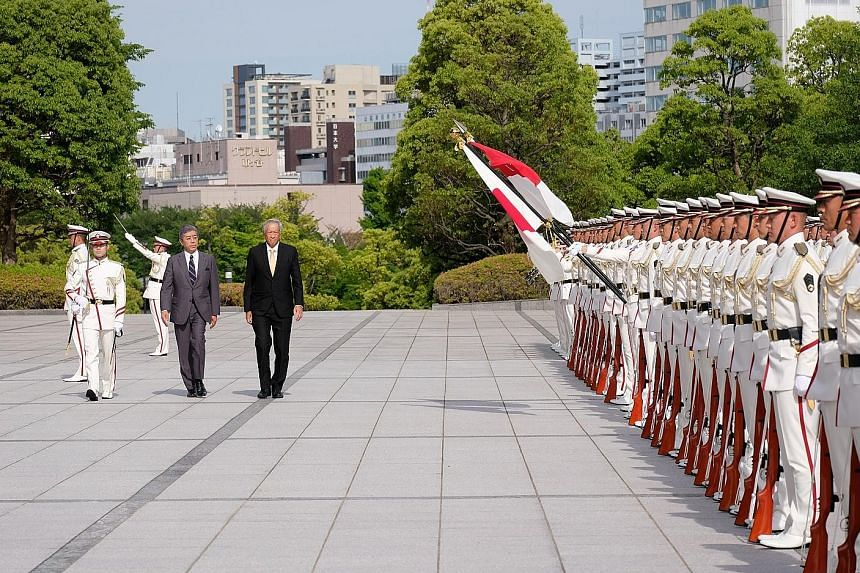 Singapore's Defence Minister Ng Eng Hen, accompanied by his Japanese counterpart Takeshi Iwaya, reviewing a Guard of Honour at the Japanese Ministry of Defence yesterday. The two ministers discussed the deepening of bilateral defence ties, as well as