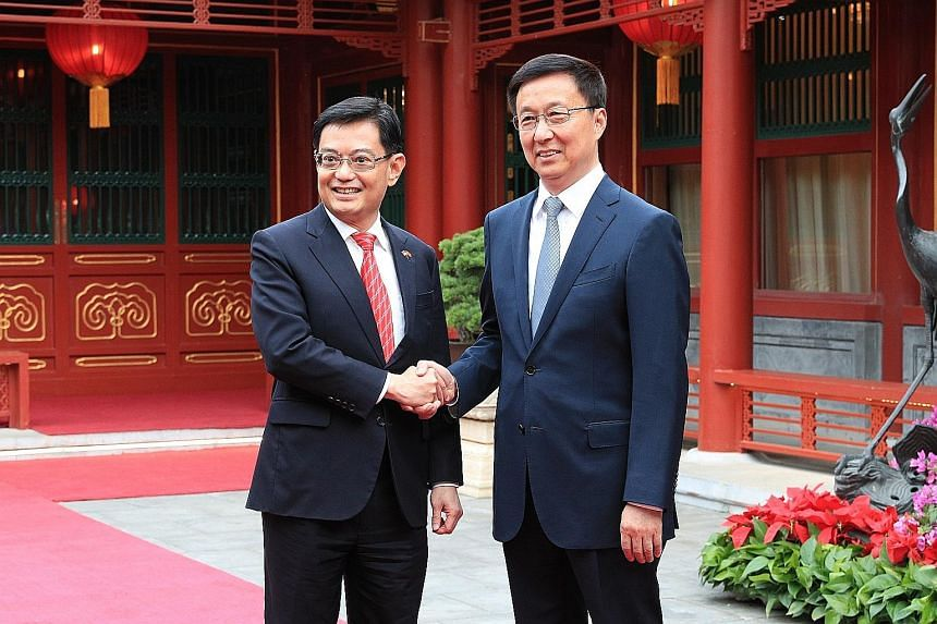 Deputy Prime Minister Heng Swee Keat with Chinese Vice-Premier Han Zheng at the Diaoyutai State Guesthouse in Beijing yesterday, at the start of his week-long visit to China.