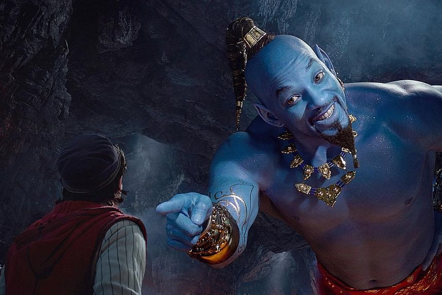 In Aladdin, Mena Massoud (far left) plays the titular character, while Will Smith plays the genie.