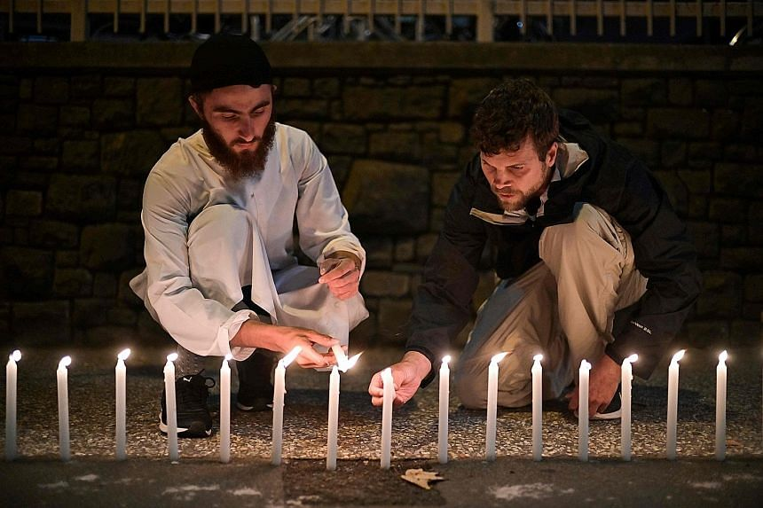 Well-wishers paying respects to victims outside a hospital in Christchurch on March 16 after the mosque shootings. Religious leaders must not deny that religions can motivate violence, says the writer.