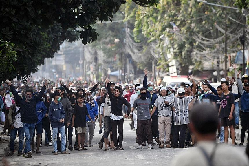 Protesters hurled Molotov cocktails, firecrackers and other projectiles at police officers during the clashes in Jakarta, causing widespread disruptions, including road diversions and the suspension of train and bus services. Protesters, some armed w