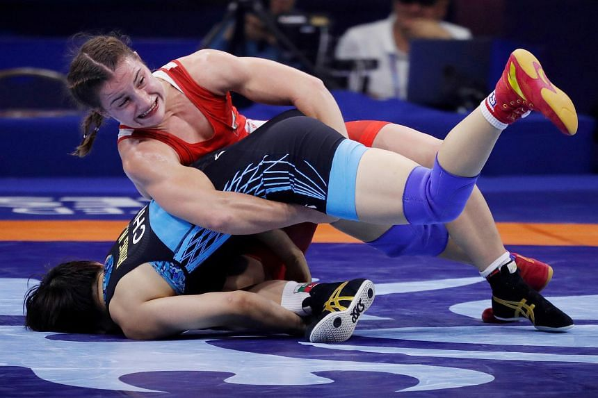 Bulgaria's Bilyana Dudova, the country's Olympic medal hope, will miss a national wrestling championship next week as her recovery would take about a month.
