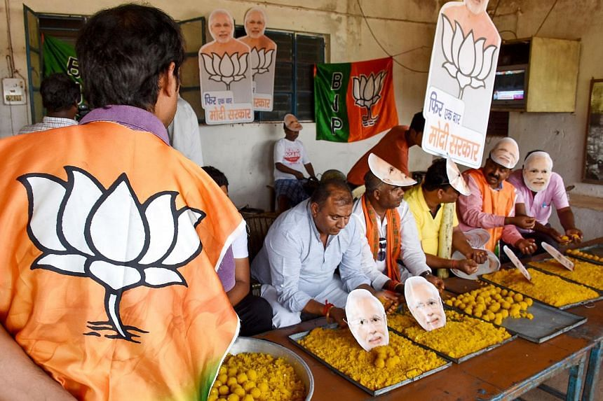 Indian Bharatiya Janata Party workers prepare laddus (sphere-shaped sweets) on the eve of the vote counting day for India's general election at the party's headquarters in Ranchi, India, on May 22, 2019.