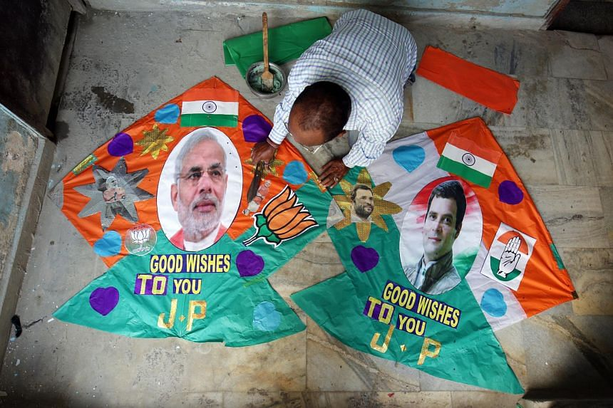 An Indian kite maker displays his specially made kites with pictures of Indian Prime Minister Narendra Modi (left) and Congress president Rahul Gandhi printed on them, in Amritsar, India, on May 22, 2019.