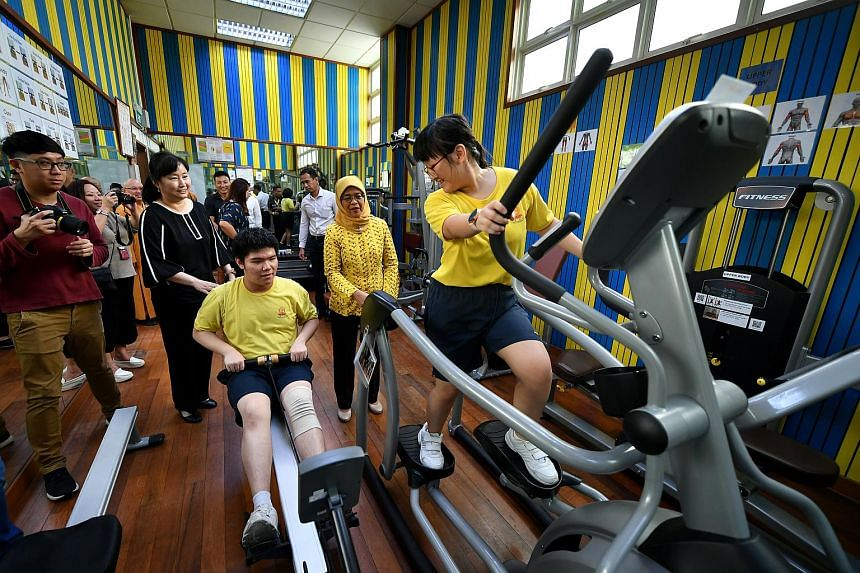 Students Tim Lee, 16, and Kimberly Ashley Sim Wun Hong, 15, working out using the rower and elliptical machine respectively in the gym inside the Indoor Sports Hall at Metta School.