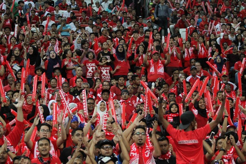 Singapore fans cheering on the Lions during match against Malaysia at the Causeway Challenge at National Stadium, on Oct 7, 2016.