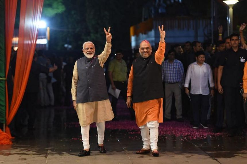 Indian Prime Minister Narendra Modi and Bharatiya Janata Party president Amit Shah celebrate their victory in the country's general election at the party headquarters in New Delhi on May 23, 2019.