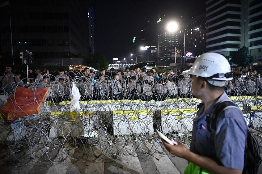 """Nearly 60,000 security personnel were deployed on May 23, 2019, nearly double the previous number, after re-elected President Joko Widodo vowed that he """"won't tolerate"""" more riots."""
