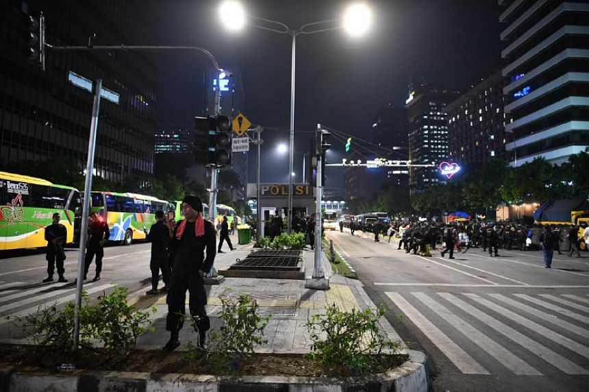 "Nearly 60,000 security personnel were deployed on May 23, 2019, nearly double the previous number, after re-elected President Joko Widodo vowed that he ""won't tolerate"" more riots."
