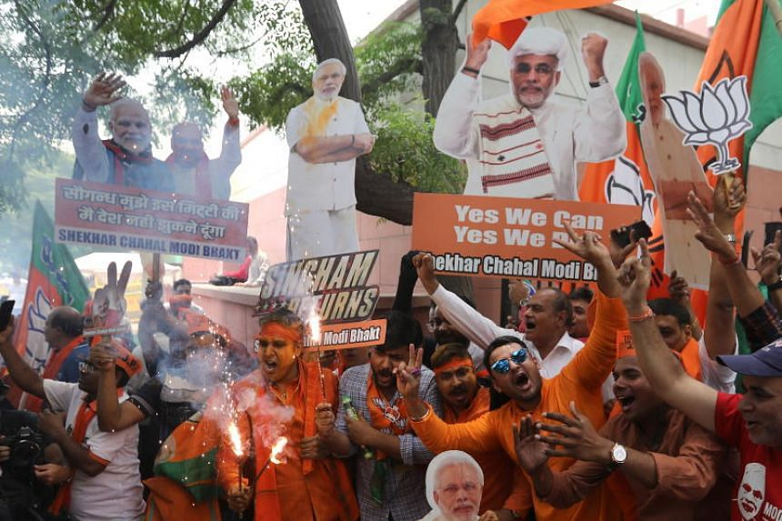Bharatiya Janata Party (BJP) supporters celebrate BJP's potential win as votes are counted for the Lok Sabha election in New Delhi on May 23, 2019.