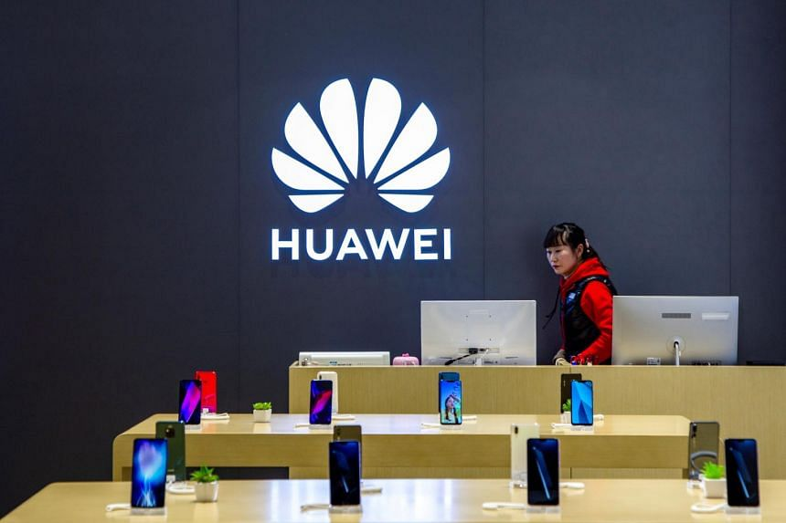 A staff member is seen inside a Huawei retail store in Shanghai on May 8, 2019.