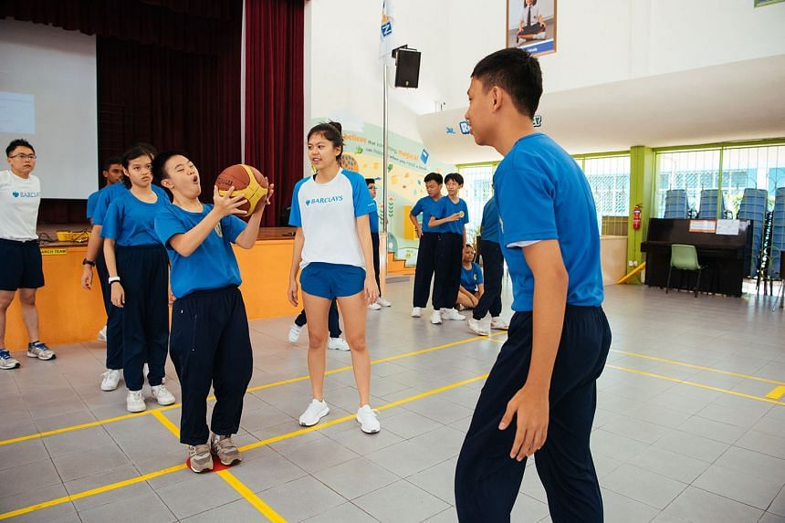 Vounteers from Barclays facilitating physical education class at APSN Katong School — a beneficiary of the TBSSF. PHOTOS: NATIONAL COUNCIL OF SOCIAL SERVICE