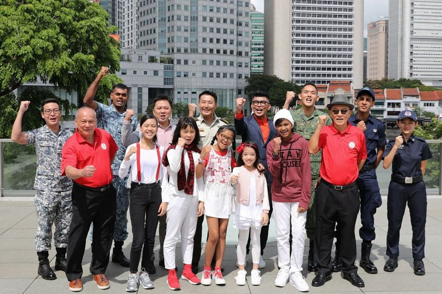 NDP executive committee members (back row, from third from left) Sydney Tan, NDP 2019 music director; Brigadier-General Yew Chee Leung, executive committee chairman; and NDP 2019 multimedia director Royston Tan with some participants of this year's p