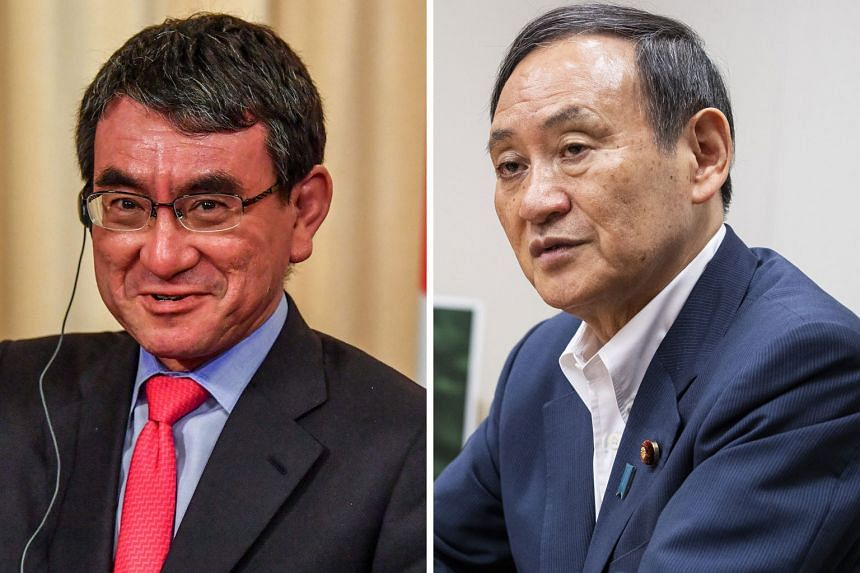 Japanese Foreign Minister Taro Kono (left) is in favour of a reversal of Japan's given-name-first convention, but government spokesman Yoshihide Suga has urged caution on the idea.