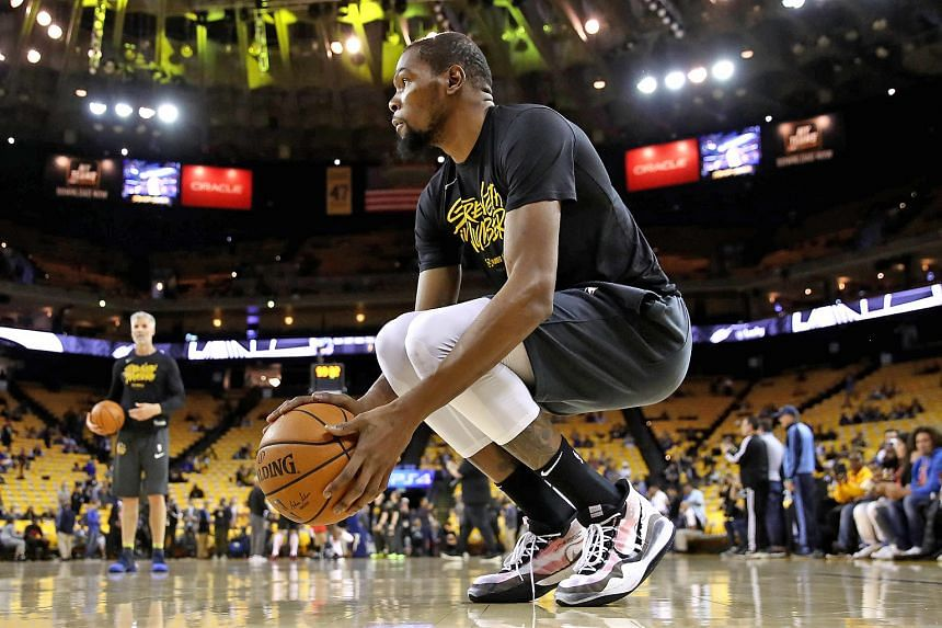 Kevin Durant is working to shake off a calf injury ahead of Golden State's assault on a fourth NBA title in five seasons. PHOTO: AGENCE FRANCE-PRESSE