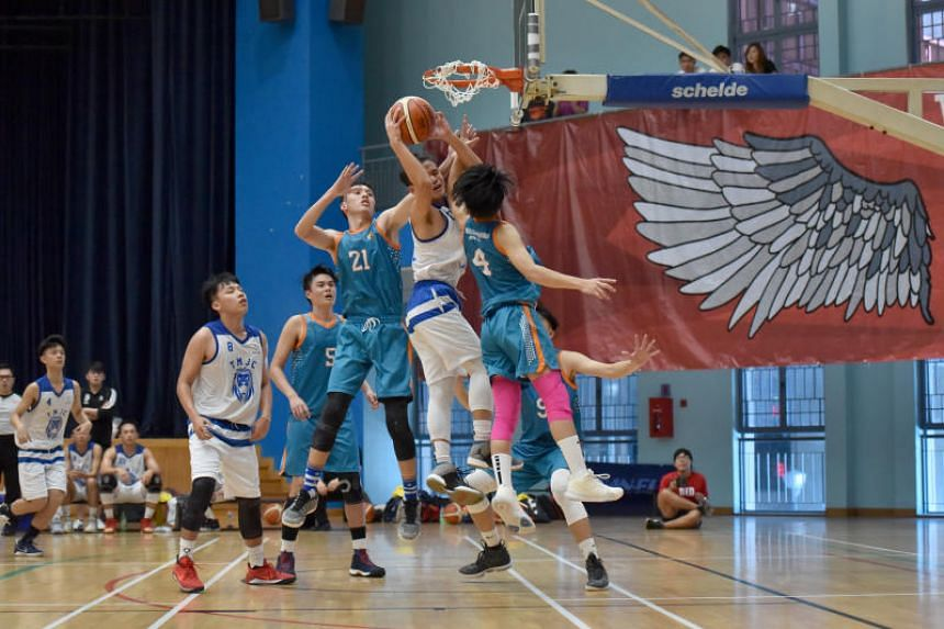 Tampines Meridian Junior College captain Tiong Chuan Yao attempts to score during the Schools Nationals A division boys' basketball final against Anderson Serangoon Junior College on May 23, 2019.