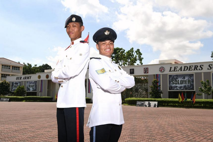 Specialist Cadets Muhammad Thaftazzani Mohammad Tayib (left) and Dela Cruz Carl Stephen Linao were among the 1,000 cadets who graduated as full-fledged specialists of the Singapore Armed Forces.