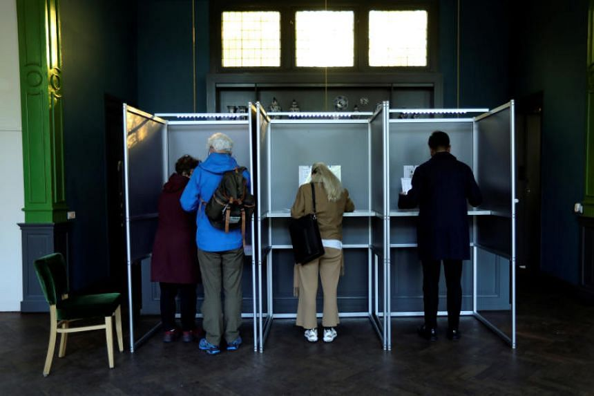 Voter cast their ballots in the European elections at Tolhuis in Amsterdam, Netherlands, on May 23, 2019.