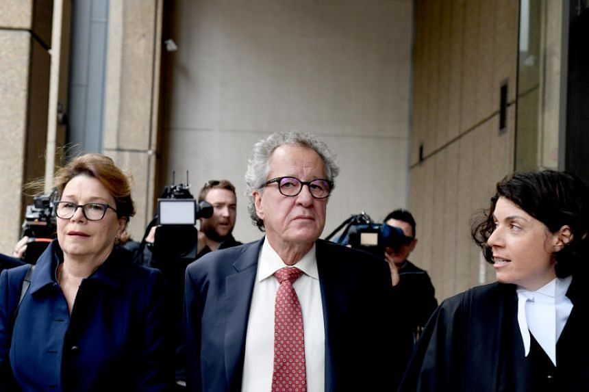 Local media reported Geoffrey Rush (centre) has been awarded almost US$2 million for lost earnings and compensation, after he was accused of inappropriate sexual behaviour toward female cast members.
