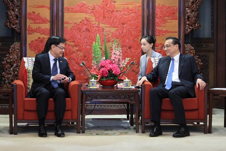 Deputy Prime Minister Heng Swee Keat (left) and Chinese Premier Li Keqiang also reaffirmed both countries' commitment to preserving an open and rules-based multilateral trading system.