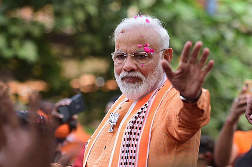 Indian Prime Minister Narendra Modi waves to his supporters during a road show in Varanasi, Uttar Pradesh, India, on April 25, 2019.