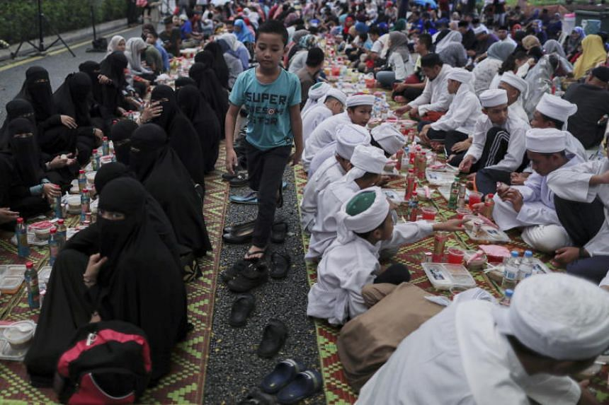 Muslims break their fast at Independence Square in Kuala Lumpur on May 18, 2019.