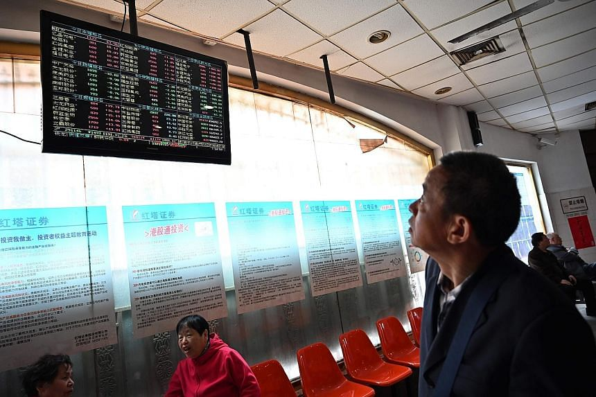 An investor monitoring stock price movements at a securities company in Shanghai earlier this month. MSCI will expand the weighting of China-listed shares in benchmark indexes tracked by global investors at the end of this month, a move analysts pred