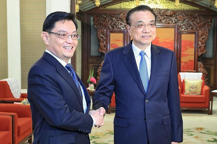 Deputy Prime Minister Heng Swee Keat and Chinese Premier Li Keqiang at the Zhongnanhai leadership compound in Beijing yesterday. DPM Heng is on a week-long visit to China that began on Wednesday.