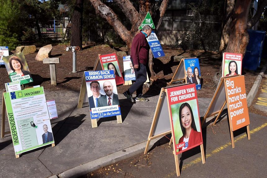 Placards for candidates in Australia's May 18 election. Australian Prime Minister Scott Morrison's government won the election, in defiance of every major public survey.