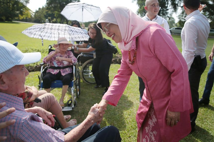 President Halimah Yacob chats with Mr Lee Kim Cheng, 91, a resident of the Thong Teck Home for Senior Citizens, at the spice garden of the Istana on May 24, 2019.