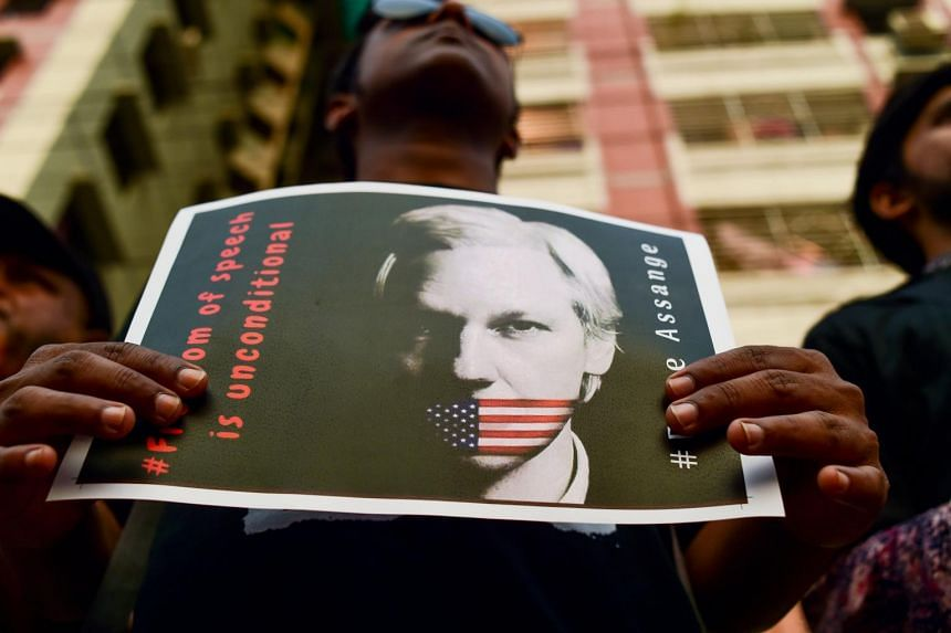 An activist holds a placard calling for the freedom of Julian Assange on April 23, 2019.