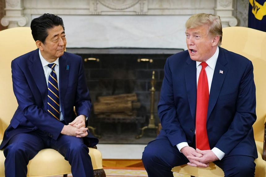 US President Donald Trump (right) met with Japan's Prime Minister Shinzo Abe in the Oval Office of the White House in Washington, DC on April 26, 2019.