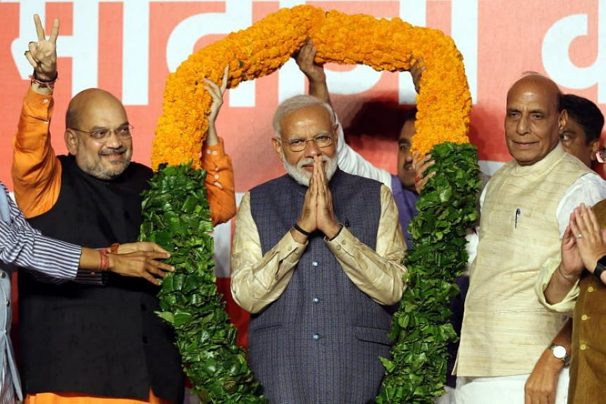 Indian Prime Minister Narendra Modi (centre) is on target to become the first leader of the Hindu nationalist Bharatiya Janata Party to win two five-year terms.