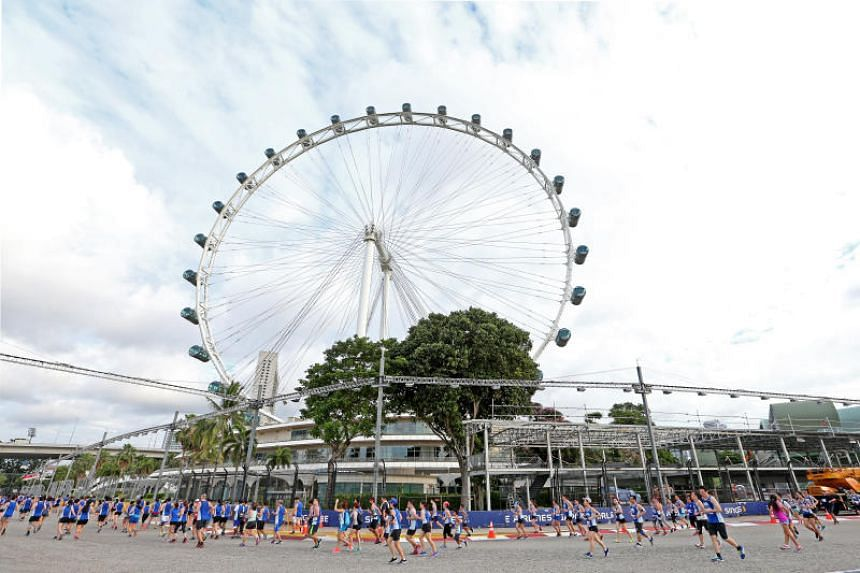 Runners participate in the ST Run 2017 at the Singapore Flyer on July 16, 2017.
