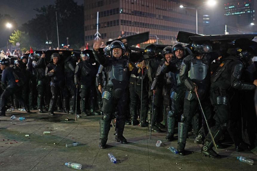 Police shout at demonstrators during a protest in Jakarta, Indonesia, on May 22, 2019.